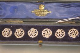 A cased set of six Edwardian silver buttons in the Art Nouveau taste, James Deakin & Sons, Chester.