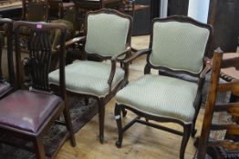 A pair of Continental oak provincial fauteuils, 19th century, each with cartouche back above a