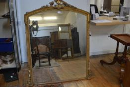A 19th century gilt-composition overmantel mirror, the arched plate within a conforming frame
