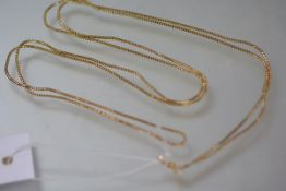 A yellow gold (unmarked) boxlink guard chain, with lobster clasp. 134cm, 24.5 grams