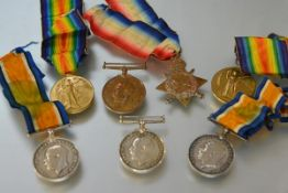 A group of World War I service medals to members of the same family, comprising: a trio, The War and