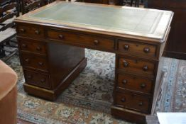 A Victorian mahogany pedestal desk, the leather-inset rectangular top with rounded corners above