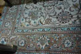A Ziegler pattern small carpet, the centre panel with leaf and lotus flower trailing design,