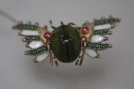 A Continental silver-gilt and enamel scarab brooch, early 20th century, the beetle with green and