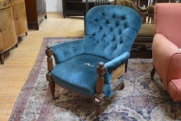 A William IV mahogany framed library armchair, the buttoned back between outcurved arms on reeded