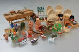 A group of 20th century doll's house furniture and accessories including: a large group of garden