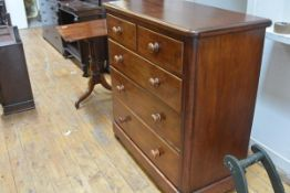 A Victorian mahogany chest of drawers, the moulded rectangular top with rounded corners over two