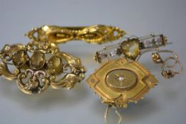 A group of late Victorian yellow metal jewellery comprising: a brooch set to the centre with a