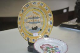 An 18th/early 19th century tin glazed pottery dish, polychrome decorated with a sailing ship, with