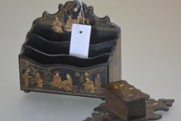 A Victorian chinoiserie decorated papier mache letter rack, gilt painted with courtly figures;