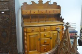 A Scottish pine kitchen dresser, mid-19th century, the superstructure with fret carved crest above a