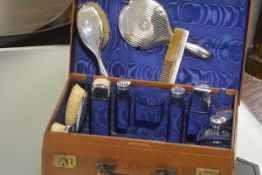 A George V lady's vanity case, by Mappin & Webb, the (partially) fitted interior with a variety of