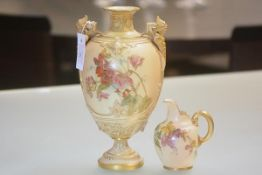 A Royal Worcester twin-handled vase, in blush ivory, of ovoid baluster form, painted with floral
