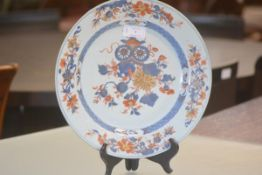 A 19th century Imari porcelain charger, in a characteristic palette painted with flowers and