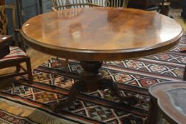 A mid-Victorian mahogany circular breakfast table, the top with moulded edge above a plain frieze,