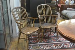 A pair of Tom Thackray hoop back Windsor armchairs, each with pierced splat, dished seat and