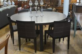 Giorgetti, a striking dining suite comprising a circular macassar wood table, the veneered top