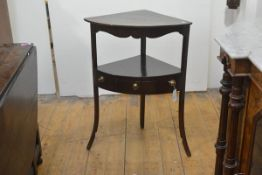 A George III mahogany corner washstand, of bowed form, fitted with a frieze drawer. 81cm by 60cm