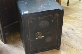 A small Victorian cast-iron safe, bearing label for S. Withers, West Bromwich, with hand and bar