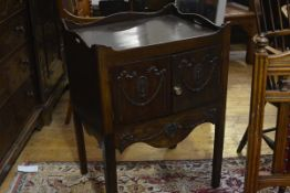A George III style mahogany pot cupboard, in the Adam Revival taste, the tray top above a pair of