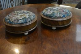 A pair of Victorian walnut footstools, circular, each with a band of Tunbridge decoration, raised on