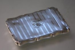 A 19th century silver-plated card case, with scalloped rim, engine turned bands and engraved with