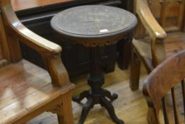 A Victorian tripod table with chequerboard top (heavily smoke damaged), circular, above a fret-