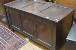 A late 17th century oak coffer, the three-panel top above a thumb moulded frieze and conforming
