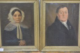 English School, c. 1840, Portraits of a Lady and Gentleman, a pair of oils, she in a lace cap, he