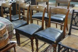 A set of seven Victorian oak dining chairs, each with tablet crest, stuffed over seat and raised