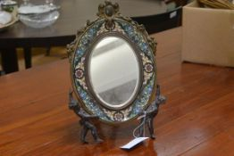A French patinated bronze and champleve enamel easel mirror, c. 1900, the oval bevelled plate within