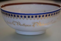 A Chinese porcelain punch bowl, with European decoration in blue and gilt and bearing the