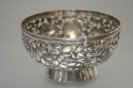 A Chinese Export silver bowl, early 20th century, of circular form, elaborately pierced with
