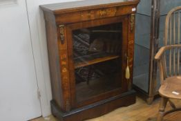 A mid-Victorian inlaid walnut gilt-metal mounted pier cabinet, the rectangular top above a glazed