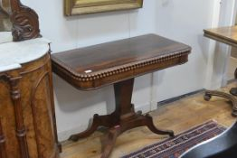 A George IV rosewood foldover tea table, of rectangular form with rounded corners, the top with