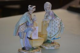 A pair of German porcelain figures, late 19th century, of a courting couple in 18th century costume,