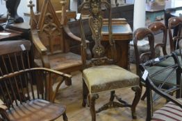 A parcel-gilt walnut high-back side chair in early 18th century style, with scroll carved crest