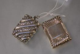 Two Victorian silver vesta cases, the first, with diagonal bands of chased foliage, hallmarked for