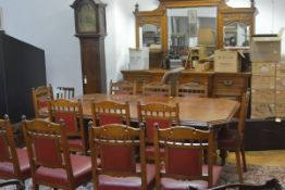 A late Victorian oak dining suite, comprising: a wind-out dining table, the rectangular top with