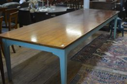 A large French fruitwood and painted kitchen table, by Chalon, the four plank top raised on blue