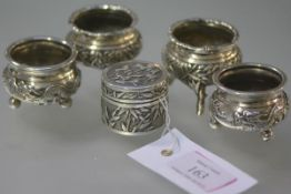 A group of Chinese Export silver by Wang Hing comprising: two pairs of cauldron salts, one chased