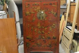 A Chinese lacquered and painted elm marriage cabinet, fitted with a pair of doors decorated with