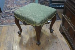 A 19th century mahogany framed footstool, in the French taste, the square upholstered seat raised on
