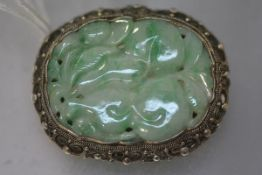 A Chinese silver-mounted jadeite plaque brooch, early 20th century, the plaque carved with fruit