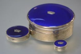 A matched set of three 1930's silver and blue enamel boxes, the largest, a jewellery box, of