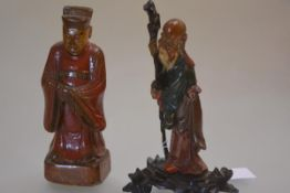 Two Chinese painted wooden figures, one Shou Lao, on an integral wooden stand, the other a Worthy,
