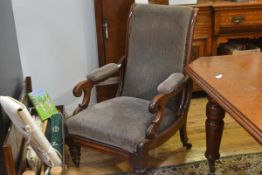 An early Victorian mahogany framed adjustable armchair, the upholstered hinged scroll back above a