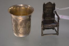 A Russian silver vodka cup or measure, late 19th century, engraved with cartouches of buildings