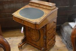A mid-Victorian inlaid walnut Davenport, with stationery box superstructure, the slant-front opening