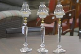 A set of three Clarke's Patent Cricklite cut and pressed glass candleholders, c. 1900, each with
